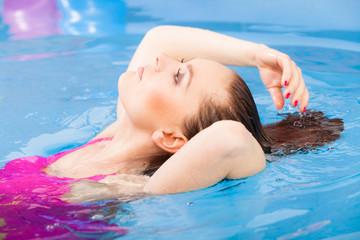 woman enjoying the water in swimming pool