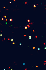 Christmas, New Year background with beautiful stars bokeh of colorful garland lights