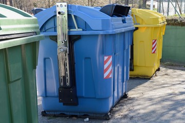 yellow, blue and green street garbage containers