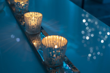Holiday background Winter Sparkling Lights and Candles Romantic Modern Atmosphere