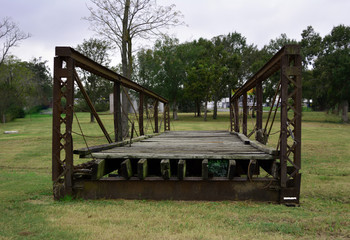 Bridge to nowhere/Old Steel and wood bridge sitting in grass