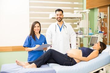 Hispanic doctors next to a pregnant woman