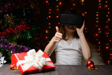 The girl received a Christmas present virtual glasses