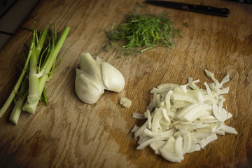 Close up view of a chopped fennel on a cutting board in a kitchen