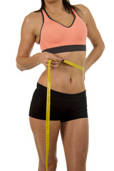 sport woman holding measure tape showing slim perfect size abs and stomach