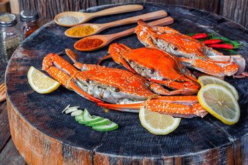 Jumbo crabs with spices on wood cutting board