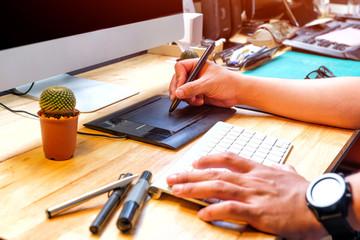 Graphic designer using computer drawing pad