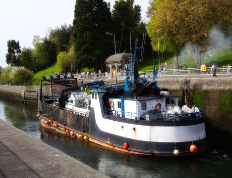 An industrial boat docked at the Ballard Locks