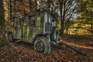 Abandoned military trailer in a forest