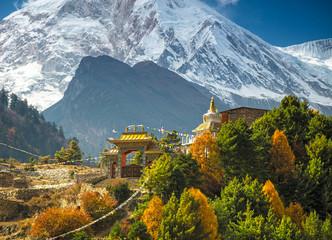 Himalayas mountain landscape. Buddhist monastery and Manaslu mount in Himalayas, Nepal. View from Manaslu circuit trek