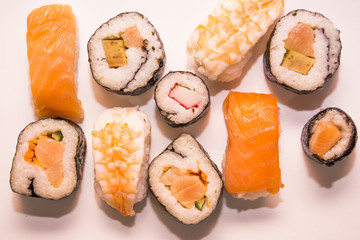 Pieces of sushi on white background