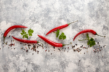 Red chili pepper on white-black background. Composition of group