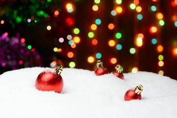 Christmas decoration balls on snow