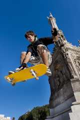 Young skateboarder in the air, in an urban environment