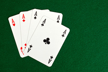 Four aces on green table.