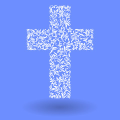 Cross from a floral ornament on a blue background
