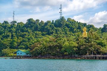 Golden Bhuddha statue sitting in village