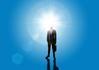 光を背に受けるビジネスマンのシルエット