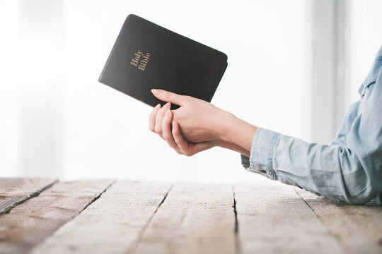 Woman reading and praying over Bible