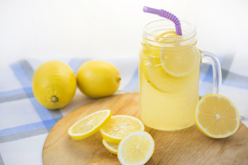 Lemonade in a transparent cup with handle