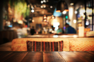 Wooden table in a cafe on the background of the bar