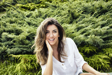 Beautiful, young, European woman smiles in nature