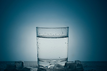 A glass of ice water. Quenching thirst water,