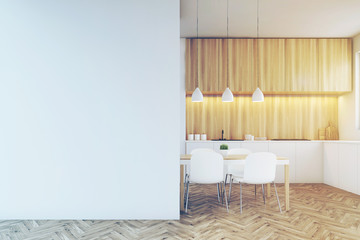 Kitchen counter, dining table and a blank wall, toned