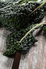 Organic lacinato kale on brown weathered wood table