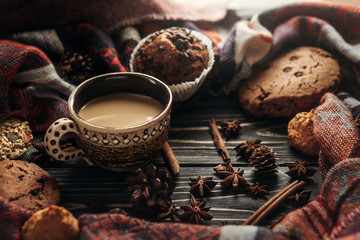 stylish rustic winter coffee cookies and spices on wooden backgr