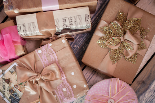 how many gifts for christmas under the tree a lot of gifts in pink and - How Many Gifts For Christmas
