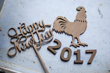 2017 Wooden numbers are on the dinner table with decorations