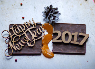 Wooden inscription Happy New Year and 2017 figures is on top of