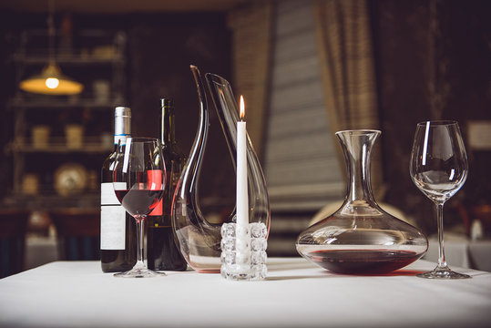Still life of scarlet wine in different utensils