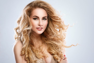 Portrait of beautiful blonde woman with curly hair