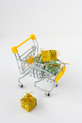 Trolley with gifts on white background