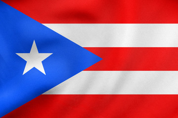 Flag of Puerto Rico waving, real fabric texture