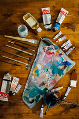 Palette of oil paints and brushes