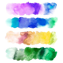 Color gradient watery illustration.Abstract watercolor hand drawn image.Yellow,purple, green and blue splash.White background.