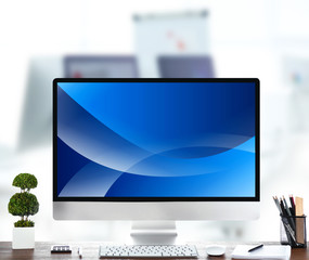 Modern workplace with computer. Wallpaper on screen.