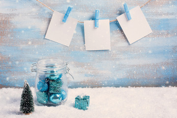 Vintage christmas composition: decorations, tree, gift and photo