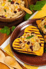 Roasted Pumpkin Stuffed with Quinoa, Nuts and Dried Fruit. Selective focus.