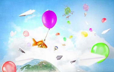 Abstract collage. floating gold fishes under baloons. . Mixed media . Mixed media