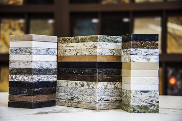 Various of stone color samples for kitchen countertops, granite, marble and quartz in different colors. Brown, gray, dark , white and black.