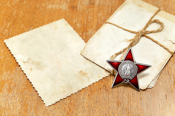 9 May to Victory Day. Order of the Red Star and old photos on th