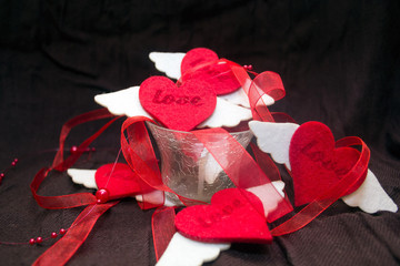 romantic background: the garland of hearts on a dark background. concept for Valentine's day, anniversary, a romantic occasion.