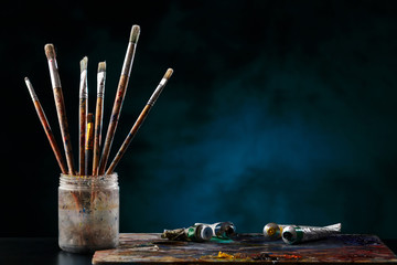 Paint brushes with a palette.