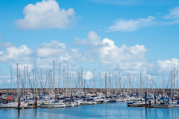Boats at the harbor with cloudy sky