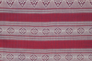 Red cotton fabric in Thai pattern for background or texture