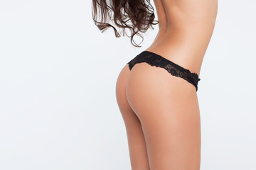 Perfect woman's back in black lace panties